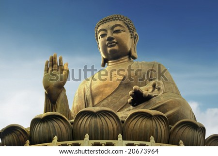 Giant Buddha Bronze Statue in Hong Kong's Lan Tau Island at the Po Lin Monastery, isolated against a blue sky. - stock photo