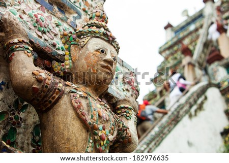 Giant Buddha in Wat Arun pagoda at Bangkok, Thailand  - stock photo