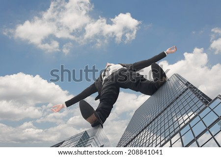 Giant businessman stand on roof of skyscraper against sky. Concept of challenge, growth, idea, big etc. - stock photo