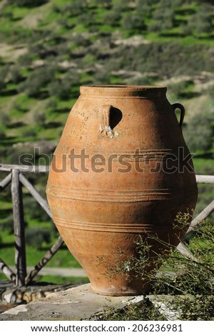 giant ceramic amphora, vase made for the storage of wine and olive, Crete, Greece - stock photo
