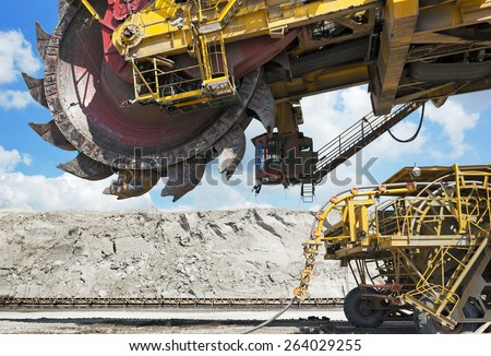 Giant coal loader in open-cast mine - stock photo
