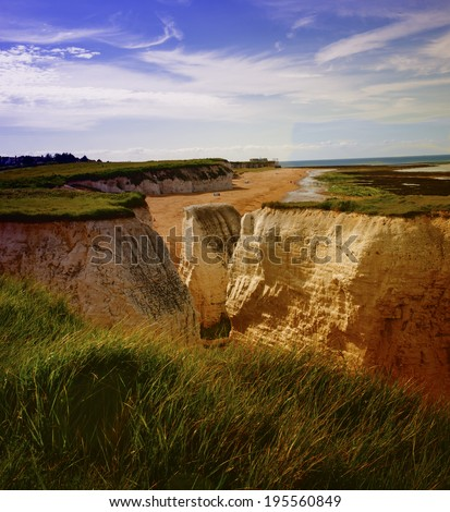 Giant coastal rock stacks seen at low tide dominating the beach at Botany Bay near Broadstairs, Kent, England. - stock photo