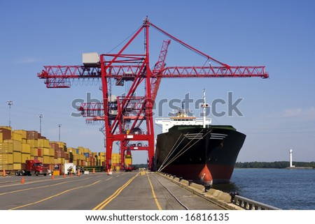 Giant container crane unloading a ship in a major port.  See other Port photos in my portfolio! - stock photo