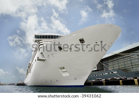 Giant cruise shipped moored at a dock