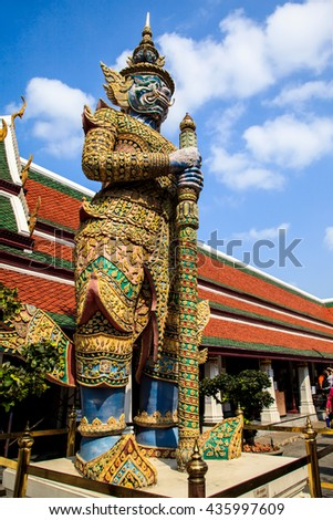 Giant demon (Yaksha) guardian of the Temple of Emerald Buddha (Wat Phra Kaew) at Grand Palace in Bangkok, Thailand.