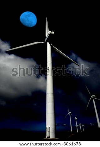giant energy wind turbines and the moon - stock photo