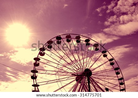 Giant ferris wheel against blue sky