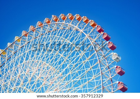 Giant Ferris Wheel in blue sky, Osaka, Japan - stock photo