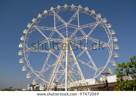 Giant ferris wheel ride built in the middle of the fairground. - stock photo