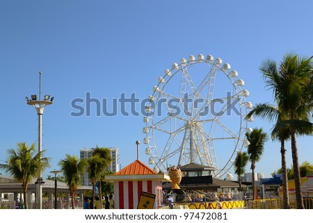 Giant ferris wheel ride built in the middle of the fairground.