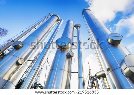 giant gas-pipes, pipelines inside refinery industry - stock photo
