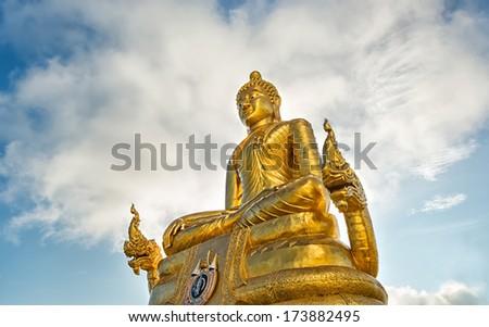 Giant golden buddha on top of Karon hill in Phuket temple area - Thailand - stock photo