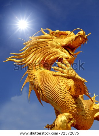 Giant golden Chinese dragon for year 1212. - stock photo