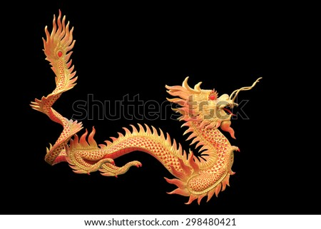 Giant golden Chinese dragon isolated on black background.   - stock photo