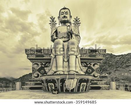 Giant golden sculpture of the Mitreya Buddha in the monastery of Likir (Likir Gompa) - Tibet, Leh district, Ladakh, Himalayas, Jammu and Kashmir, Northern India (stylized retro) - stock photo
