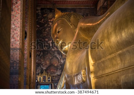 Giant golden statue of Buddha in Wat Pho, Bangkok. Figure is 15 m high and 46 m long, and it is one of the largest Buddha statues in Thailand. No property release required