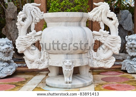 Giant joss pot with dragon in Chinese temple
