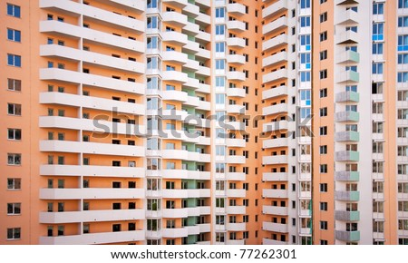 Giant multi-apartments building. Background or texture - stock photo
