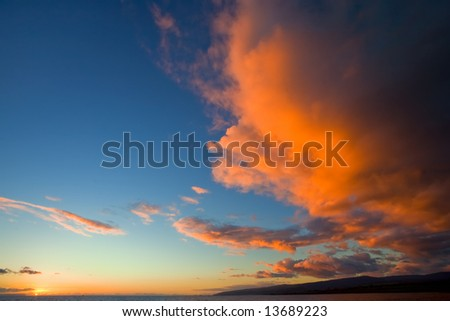 Giant orange cloud over island - stock photo