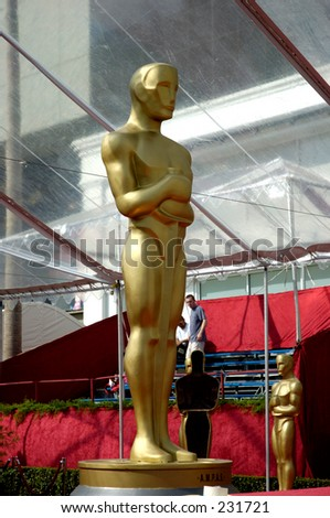 Giant Oscar statue at the entrace of the red carpet. - stock photo