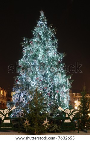 Giant outdoor christmas tree decorated with lights illuminated at night - stock photo