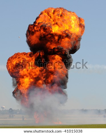 Giant outdoor explosion with fire and black smoke - stock photo
