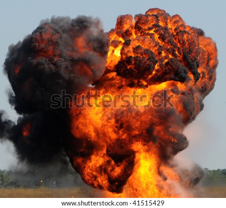 Giant outdoors explosion with fire and black smoke - stock photo