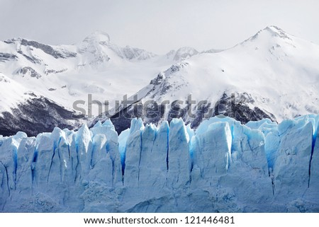 Giant Peaks of a Blue Glacier and Snowcaped Mountains
