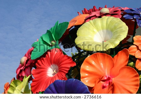 Giant plastic flower sculpture on a bright sunny day - stock photo