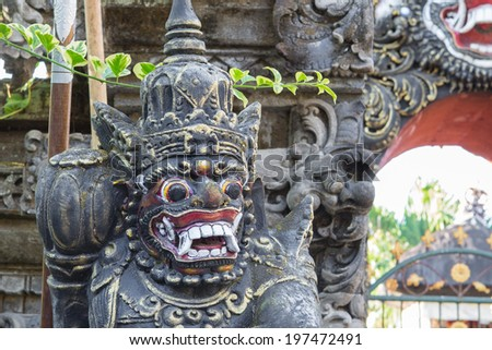 Giant protect the door of Hindu temple in Bali  Indonesia
