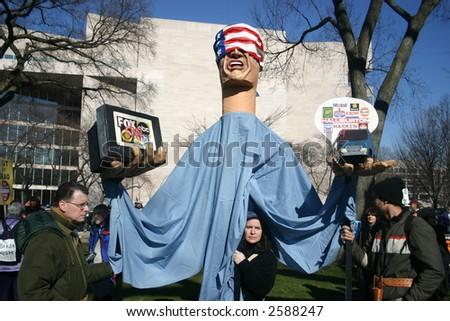 Giant puppet at anti war rally on the National Mall, Washington, DC, Saturday, January 27, 2007. - stock photo