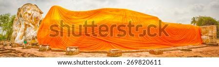 Giant Reclining Buddha in Wat Lokayasutharam. Ayutthaya historical park. Panorama - stock photo