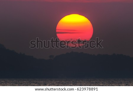 Giant red setting sun, Thailand