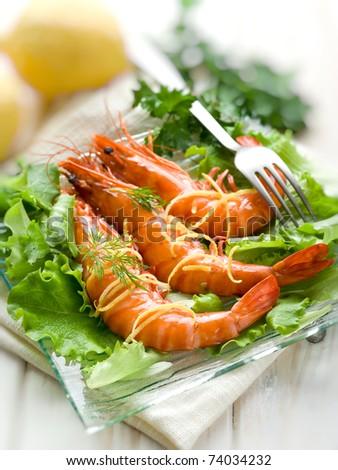 giant shrimp over lettuce - stock photo