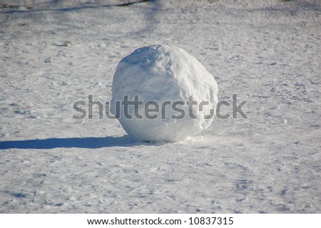 Giant snowball on frozen field.  Canada.