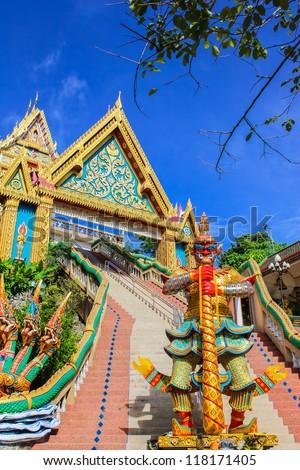 Giant statue  and entrance gate at Kao Rang temple, Phuket, Thailand - stock photo