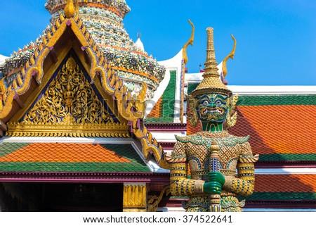 Giant statue at Temple of the Emerald Buddha (Wat pra kaew) , Grand palace ,Bangkok,Thailand. - stock photo