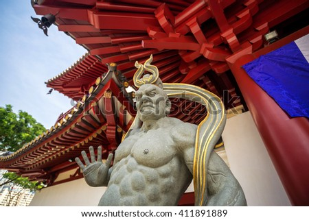 Giant statue in the Buddha Tooth Relic Temple ; They are guard of the door - stock photo