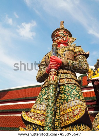 Giant statue in Wat Phra Kaew and blue sky at Bangkok, Thailand
