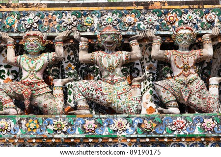 Giant statues around the base Chedi Wat Arun in Bangkok city, Thailand - stock photo