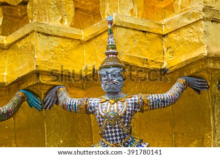 Giant statues at the Golden Pagoda in Temple of the Emerald Buddha, the Grand Palace, Bangkok, Thailand - stock photo