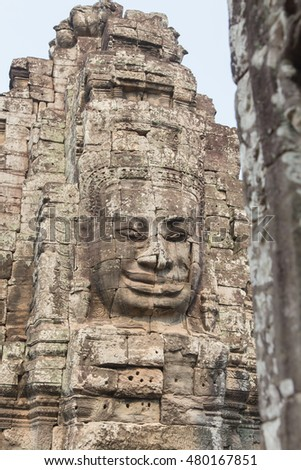 Giant stone face at Bayon Temple, Angkor Wat , Cambodia