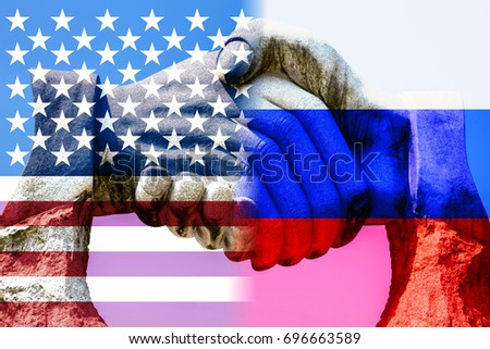 Giant stone handshake shining through the us and russian flag peace concept