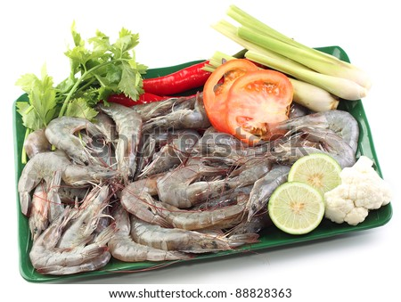 Giant tiger prawn with tomatoes, key lime, chilies, lemongrass, and salad. - stock photo