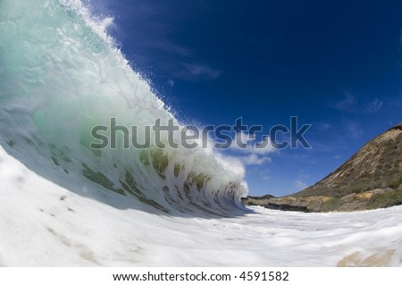 giant wave breaking at sandy beach on oahu - stock photo