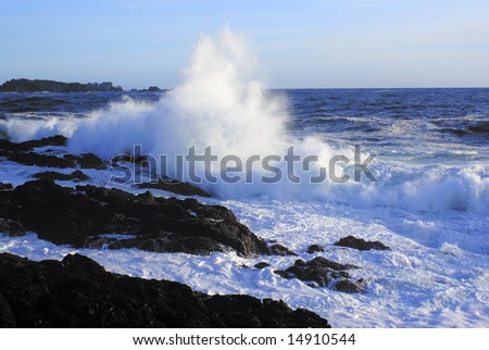 Giant wave crushing on a rocky beach on Vancouver Island - stock photo
