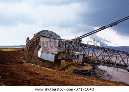 Giant wheel of bucket wheel excavator in a coal open pit in Rhineland, Germany - stock photo