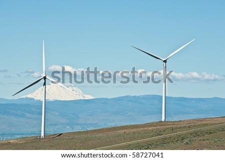 Giant wind turbines on a mountain ridge - stock photo