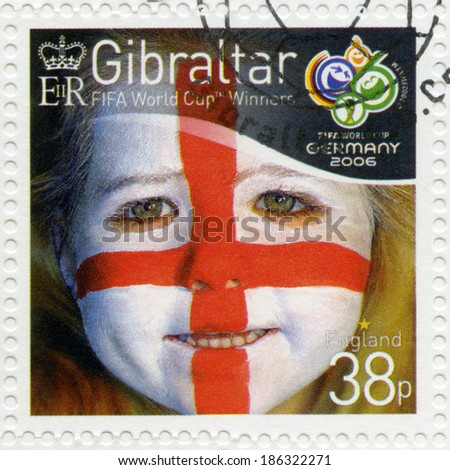 GIBRALTAR - CIRCA 2006 : A stamp printed in Gibraltar shows child with face painted as flag of England, devoted 2006 World Cup Soccer Championships, Germany, circa 2006 - stock photo