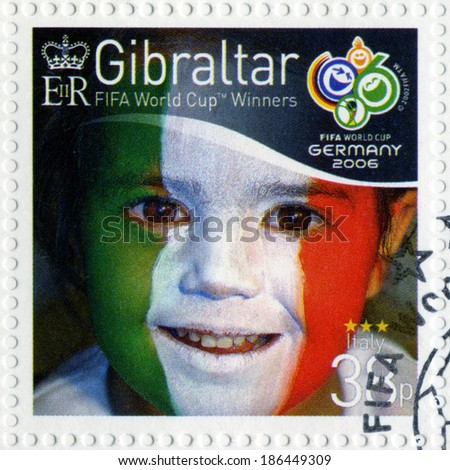 GIBRALTAR - CIRCA 2006 : A stamp printed in Gibraltar shows child with face painted as flag of Italy, devoted 2006 World Cup Soccer Championships, Germany, circa 2006 - stock photo